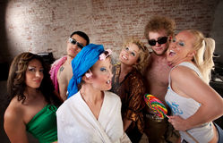 1970s Disco Music Party. Funny woman in curlers teased at a 1970s Disco Music Party Royalty Free Stock Images