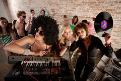 1970s Disco Music Party. Cool female DJs performing at a 1970s Disco Music Party royalty free stock images