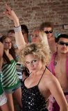 1970s Disco Music Party. Cute lady dancing at a 1970s Disco Music Party stock images