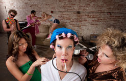 1970s Disco Music Party. Funny woman in curlers teased at a 1970s Disco Music Party Stock Photo