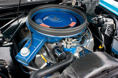 1971 Ford Mustang 8 Cylinder Engine 351C. 1971 to 1973 Ford Mustang eight cylinder engine, painted blue with blue air cleaner assembly.  Factory original 351 Royalty Free Stock Photos