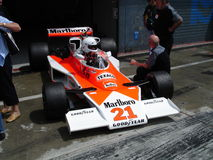 1976 McLaren M23. Exiting the pits at Monza Royalty Free Stock Images