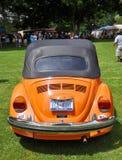 1976 Orangen-Volkswagen-Käfer Stockbild