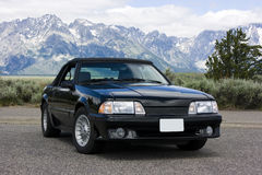 1987 Ford Mustang Convertible Black. 1987 black Ford Mustang convertible GT photographed at the Grand Tetons near Jackson Hole, Wyoming.  Turbine wheels, black Stock Photos
