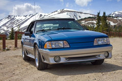 1989 Ford Mustang Convertible Blue. 1989 blue Ford Mustang convertible GT photographed at the Continental Divide near Breckenridge, Colorado. Blue and silver two royalty free stock photos