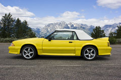 1991 Ford Mustang Convertible Yellow. Yellow 1991 Ford Mustang convertible GT photographed at the Grand Tetons near Jackson Hole, Wyoming.  Cobra wheels, yellow Stock Image