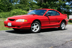 1994 Ford Mustang Coupe GT. 1994 red Ford Mustang coupe, GT model with 5-star pattern wheels stock photo