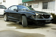 1998 Ford Mustang Cobra Wreck. 1998 Ford Mustang Cobra with hood, fender and front bumper damage Royalty Free Stock Photos