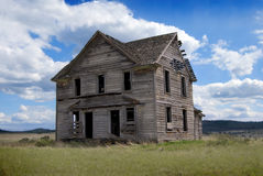 19th Century Abandoned Homestead. 19th Century House in Central Oregon sitting in a rural field against blue cloudy skies Royalty Free Stock Images