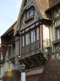 19th century frontage 1 , Deauville, France. 19th century timbered façade in Deauville, France, with tiles, carved wooden columns and ceramic animal subjectage Royalty Free Stock Photography