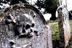 19th Century Grave 1. Weird Skull Graves at Mellis Church, Mellis, Suffolk, England Stock Photo