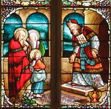19th century stained glass. Window in Uzeste church, France Stock Photos
