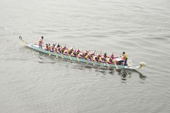 1Malaysia International Dragon Boat Festival 2010. PUTRAJAYA, MALAYSIA - JUNE 19 : Participant rowing their boats during the 1Malaysia International Dragon Boat Royalty Free Stock Image