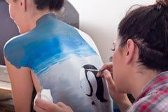 1张回到机体女孩绘画s 免版税库存照片