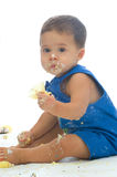 1st Birthday. Adorable one year old boy eating cupcakes Stock Photo