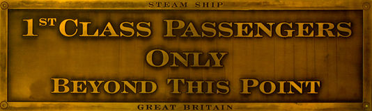 1st Class Passengers Only - Brass Sign. An historical brass sign which makes it clear that only first class passengers are allowed beyond a certain point Stock Photos