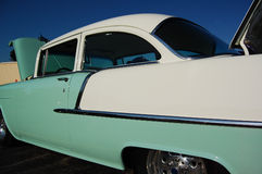 1st Classic car. This is a classic car. Dominant colors are sea foam green, white and Blue sky Stock Photo