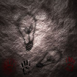 1st Thought. Idea shadows are cast upon a neolithic cave wall along with red and black hand prints Stock Illustration