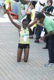 1st Winner of KL Marathon. Kuala Lumpur, June 26 : Rose Kerubo Nyangacha winning the 42K women open category of Standard Chartered KL Marathon 2011 a Stock Photo