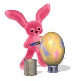 2个兔宝宝复活节彩蛋绘画 免版税库存图片