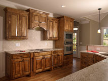 2个家厨房豪华槭树设计 库存图片