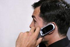 2个执行委员电话年轻人 免版税库存图片