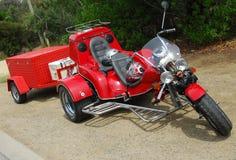 2个红色三轮车 库存照片