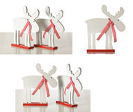 2台圣诞节个人计算机驯鹿木材白色 免版税库存照片