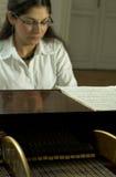 2实现的钢琴演奏家钢琴 免版税库存图片