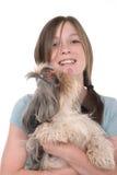 2拿着小的小狗的女孩 库存图片