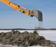 2条胳膊开掘的挖掘机 库存照片