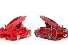 2辆汽车丹尼斯发动机起火新的老玩具& 库存照片