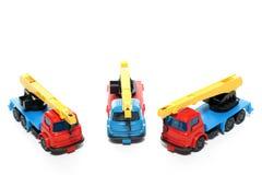 2辆贝得福得起重机塑料卡车 免版税图库摄影