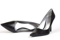2黑色脚跟高s穿上鞋子妇女 库存照片