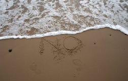 2 κανένα γράψιμο άμμου Στοκ φωτογραφία με δικαίωμα ελεύθερης χρήσης