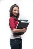 2 азиатских книги держа студента Стоковая Фотография