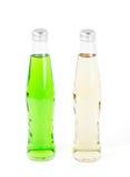 2 бутылки лимонада на белизне Стоковое фото RF