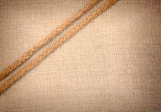 2 веревочки идя раскосно на предпосылку ткани Стоковое Изображение RF