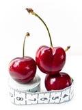 2 вишни измеряют ленту Стоковые Изображения