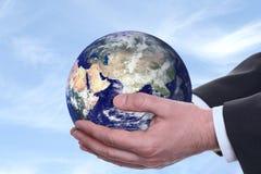 2 голубых руки земли Стоковое Изображение