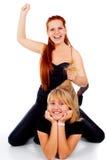 2 девушки кладут на пол, и игру Стоковые Изображения
