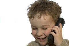 2 детеныша телефона мальчика Стоковая Фотография