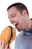 2 детеныша человека гамбургера еды гигантских Стоковые Фото