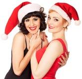 2 женщины нося танцевать шлемов Санты Стоковые Фотографии RF