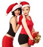 2 женщины нося шлемы santa Стоковое фото RF
