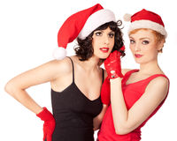 2 женщины нося шлемы santa Стоковые Изображения RF
