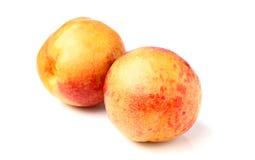 2 зрелых персика Стоковые Изображения