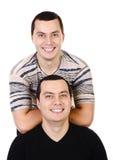 2 изолированного близнеца молодых человеков привлекательных позитва ся Стоковые Фото