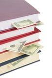 2 книги придают форму чашки доллары Стоковое Изображение RF