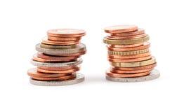 2 колонки различных монеток Стоковая Фотография